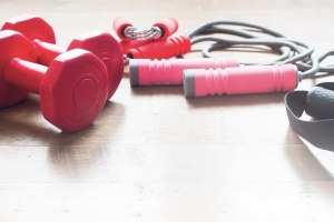 Sport equipments on wooden floor